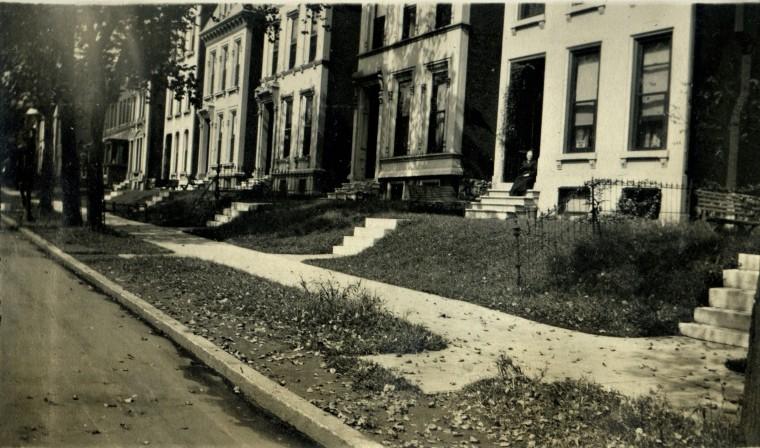 townhouse row with Grandma Sallie_c. 1920 maybe