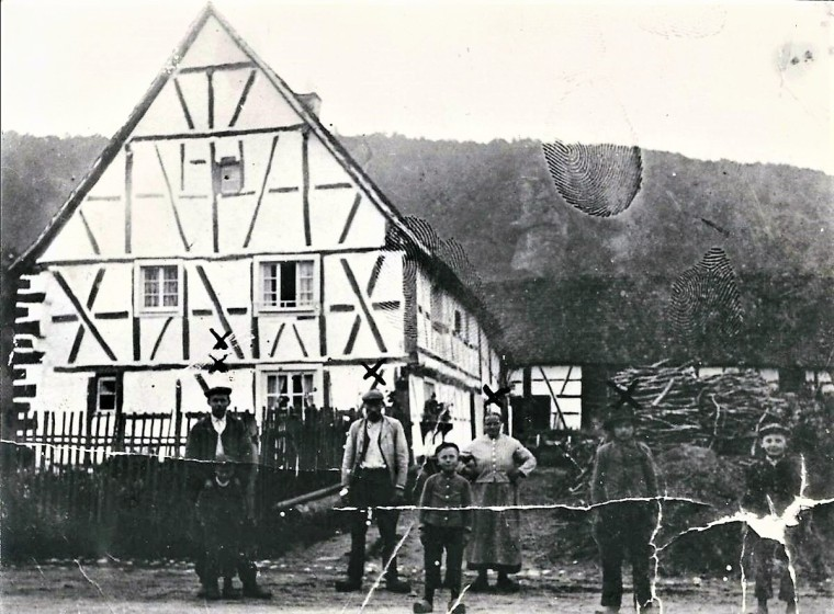 Family in front of Obersteinbach house, est. 1890s - Copy